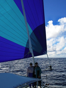Steve and Dorothy with spinnaker in mid ocean South Pacific enroute to French Polynesia
