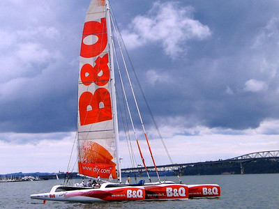 """We watched Ellen Macarthur's monster just-launched tri """"B&Q"""" undergoing sea trials in Auckland Harbour. She broke all 'round the world single handed sailing records in this boat on Feb 7, 2005."""