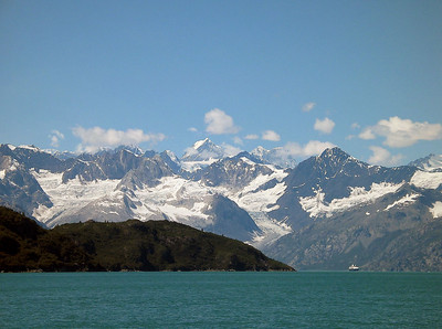 Glaciers fill the valleys between the mountains along the west arm of Glacier Bay