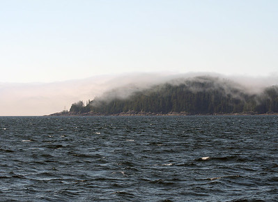 ADAGIO rounds Cape Decision, the southernmost point of Kuiu Island, from Sumner Strait