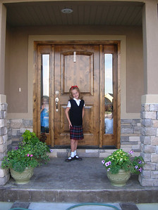 The Princess Ready for her first day of 2nd Grade.  (Her cute brothers peaking through the windows, dying to see her go!)