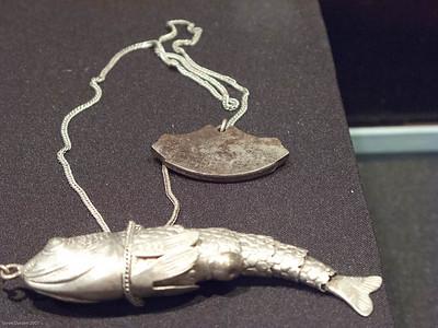 Silver sculptured tool.