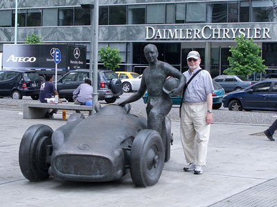 Steve poses with the sculpture of the famous race car driver Juan Fangio.