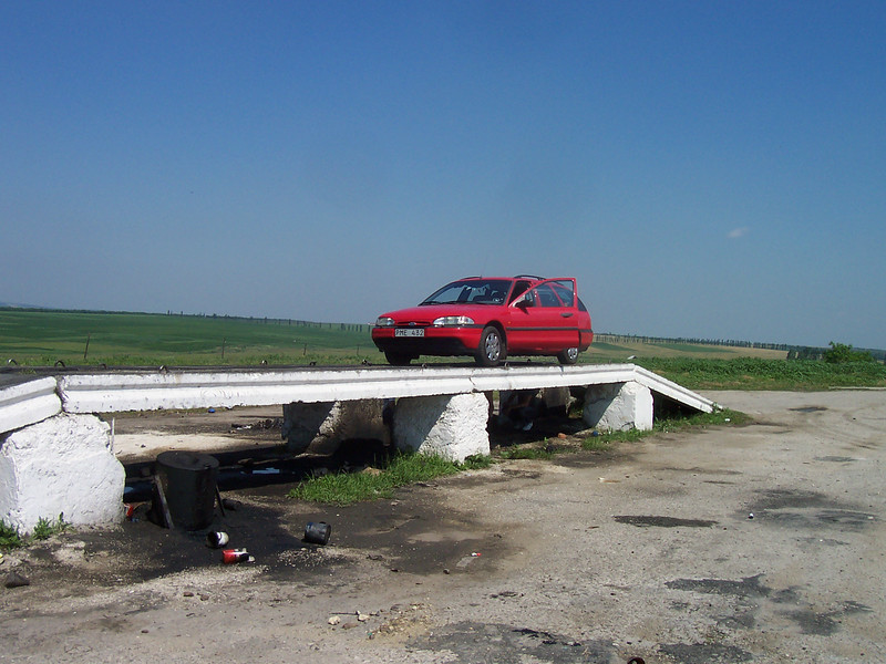 we stopped to have a look under the car. to see if anything was loose. the roads had significant holes. these ramps came in handy.