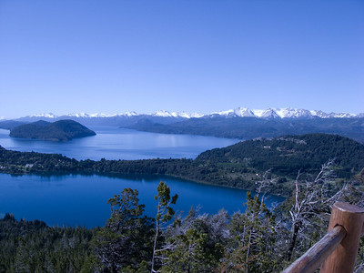 Photo 4 of the panorama shows a region of the large Lake Nahuel Huapi and the Andes mountains.