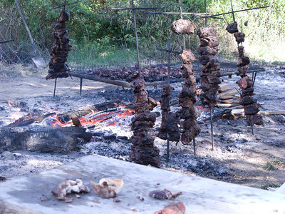 Meanwhile, men were cooking beef over the open fire, carne asada.