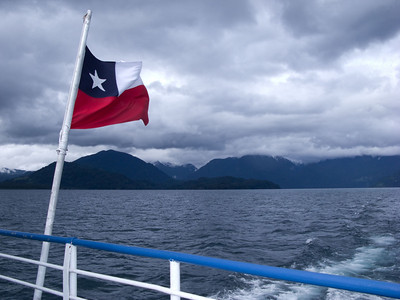 The Chilean flag flies from the stern of our boat.