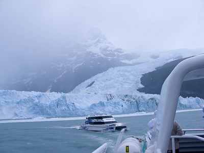 The other tour boat passes the face of the glacier.