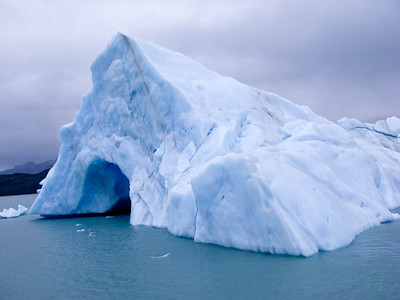 Another Ice berg with a tunnel through it.