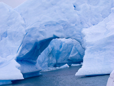A hole in an ice berg is a common formation.