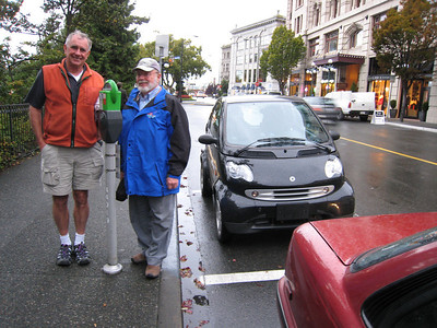 Joe and Steve admire the small car parking space in Victoria, BC