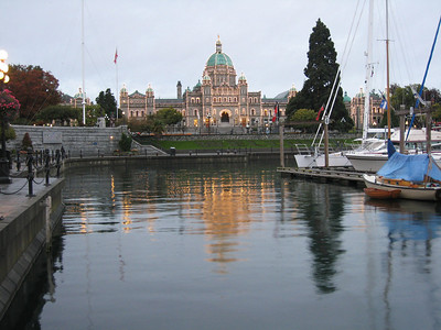 ADAGIO basks in the glow of the evening lights of the Parliament House in Victoria, BC