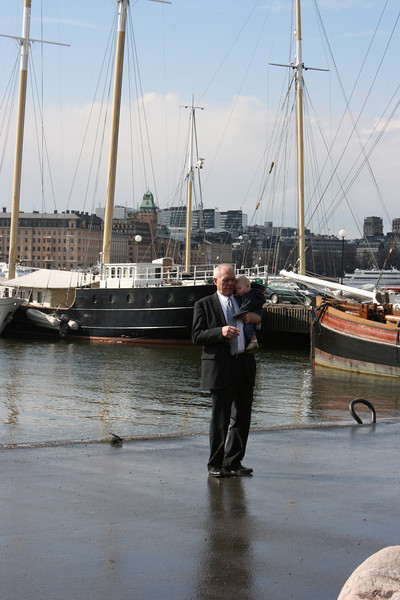 Grandpa Bob and Baby Chase in Stockholm looking at ships
