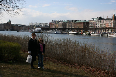 Grandma Jeane and Emme at the water edge in Stockholm