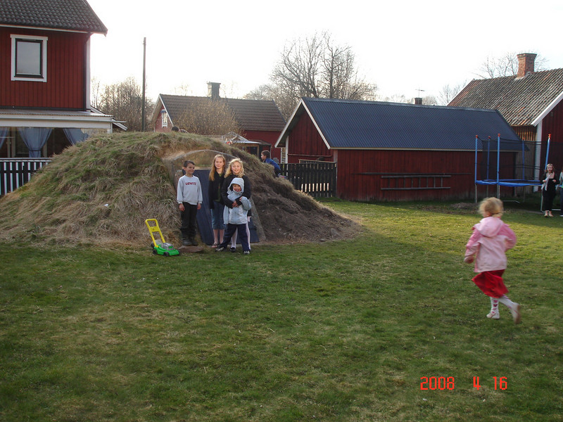Em playing games with the Swedish Children