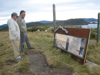 Steve and Adrian reading interpretive materials at Cape Bruny