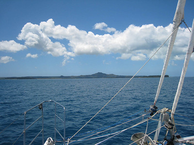 Approaching Isle of Pines with Pic Nga mountain in the distance.