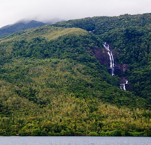 Waterfalls cascaded in ribbons from the top of Mount Panie' and the UNESCO World Heritage special botanical reserve.