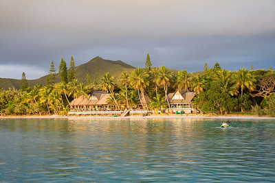 The setting sun lighted the Kou Bugny Hotel cafe as George and Penelope kayaked ashore.