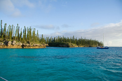We anchored behind the reef at Oro Bay, near the pass between the two small islands.