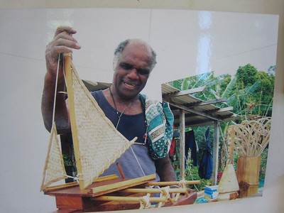 Craftsman displays his model outrigger canoe.