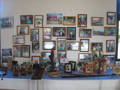 Display of the village's favorite photos at the Vao village visitors center. Handcrafts on the table are for sale.