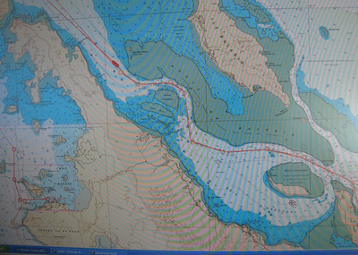 The chart shows our route as we wind our way through the reefs to starboard with the mountain ridges to port.