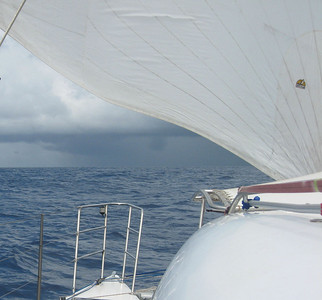 Rainclouds ahead, beneath our reacher sail