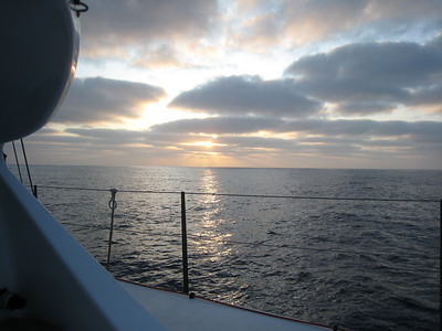 Sunset on our fourth day at sea. Very light wind so we are motorsailing on port engine.