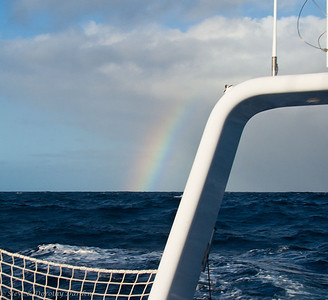 "Day 4: The rainbow encourages the hope of a good ""boat wash"" -- we are crusted in salt everywhere."