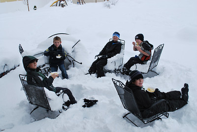 Ryan and his friends hanging out, having lunch in the snow!