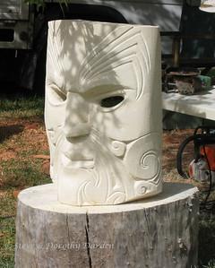 Mask carved in Oamaru stone by Pita Rua