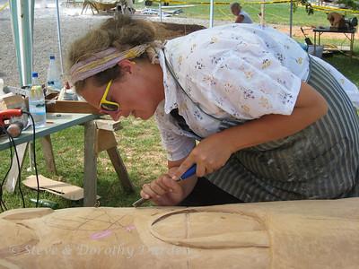 """Elizabeth Alexander carves """"A Northland Tapestry"""" from a large totara log."""