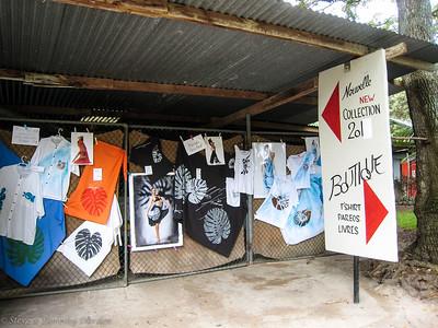 Display of Albert's silk screened hand painted fabrics