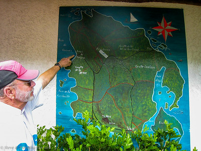 Steve points to location of Bay at Ouamaeo on a map of the Isle of Pines.
