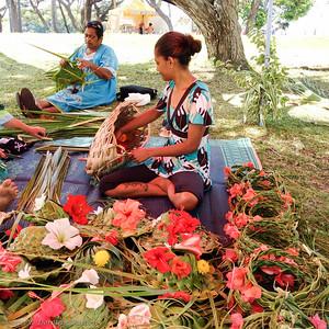 Local women weave pandanus leaves.