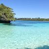 Snorkeling is good around this islet in Kanumera Bay (panorama)