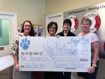 Nita Penland of Winchester was the lucky winner of $5,000 in Animal Harbor's 2016 Bone Drop
