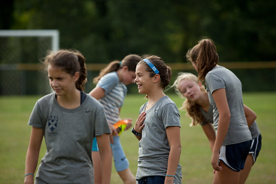Members of the SAS middle school girls' soccer team take a break during preseason practice. Photo by St. Andrew's-Sewanee