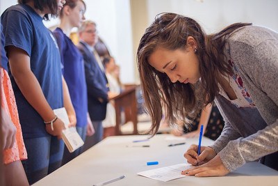 St. Andrew's-Sewanee senior Madison Gilliam signs the Honor Code, an opening of school tradition at the school