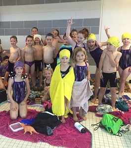 The 6 and under swimmers and the 7–8 swimmers of the Tigersharks swim team celebrate the win. Photo by Marion Knoll