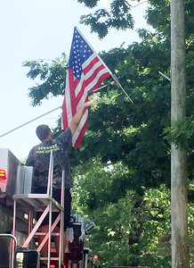 The Sewanee Volunteer Fire Department hung up American  flags along the July Fourth parade route on Flag Day. Photo by Doug Cameron