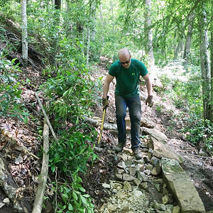 A volunteer works on the Fiery Gizzard reroute project. Photo by South Cumberland State Park