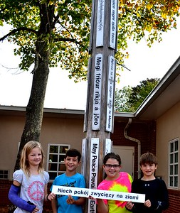 SES students Julia Sumpter, Robbie Philipp, Samantha Eklund and Austin Ellio at the Peace Pole. Photo by Sewanee Elementary