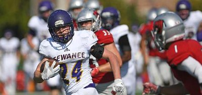 Sewanee's Warren Holland, a freshman running back, carries the ball against Washington University