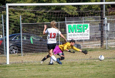 Eliza Masters (No. 13) attacks the goal