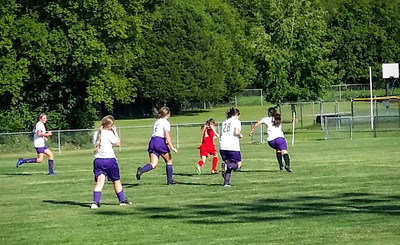 Ella Masters (center) plays in a recent soccer match