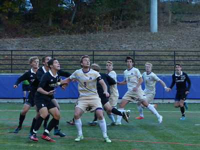 Sewanee's Ramsay Seagle (No. 9) ba les the Centre opponents in the Oct. 22 soccer match. Photo by Lyn Hutchinson