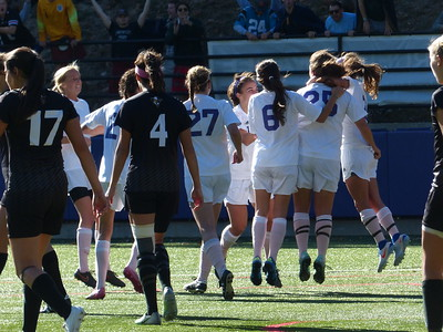 The women's soccer team celebrates the first goal of their big game against Centre College on Oct. 22. Photo by Lyn Hutchinson