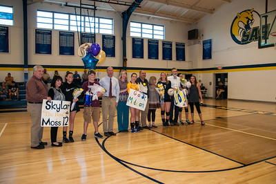 SAS seniors Skylar Moss, Madison Gilliam, Lydia Angus and Addie Babcock, with family,  friends and coach, were honored prior to the Sept. 28 volleyball match